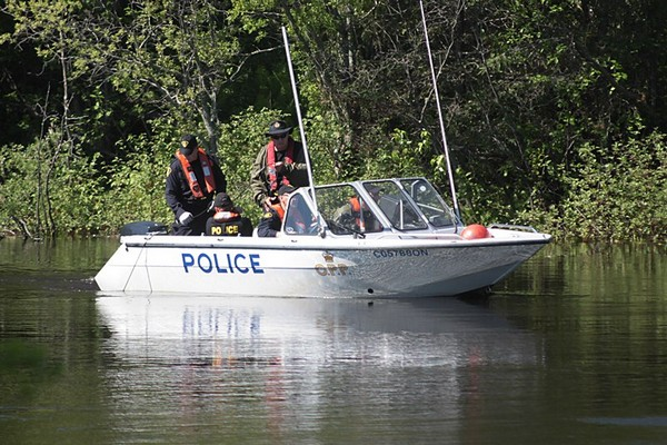 FILE -- OPP search teams conduct a search on the Kam River for a missing boater in this June 2013 file photograph. The search for the missing boater resumed Wednesday.