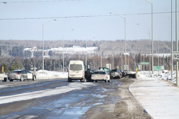 FILE -- Police investigate the scene of a fatal highway crash on the Thunder Bay Expressway in this March 2014 file photograph. Two people were killed as a result of this crash, and the man accused of impaired driving and criminal negligence causing death returned to court Tuesday.