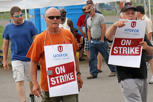Workers remain on strike Friday outside the Montreal Street Bombardier plant.