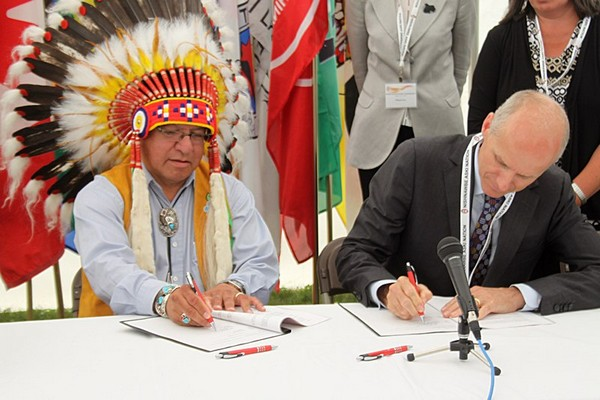 NAN Grand Chief Harvey Yesno and Cancer Care Ontario president and CEO Dr. Michael Sherar signing the relationship protocol as part of the CCO
