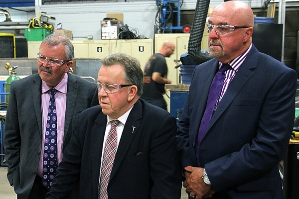 From left: Confederation College president Jim Madder, MPP Michael Gravelle and Thunder Bay Mayor Keith Hobbs take in a welding demonstration at Confederation College on Friday.