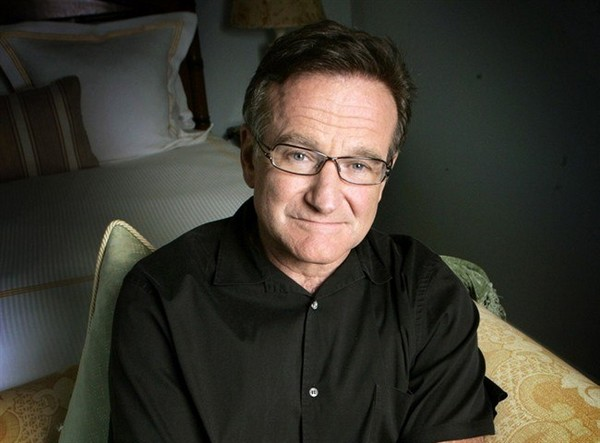 "This June 15, 2007 file photo shows actor and comedian Robin Williams posing to promote his film, ""License To Wed"" in Santa Monica, Calif. Canadian comedians are mourning the death of American comic and actor Robin Williams as the loss of one of comedy"