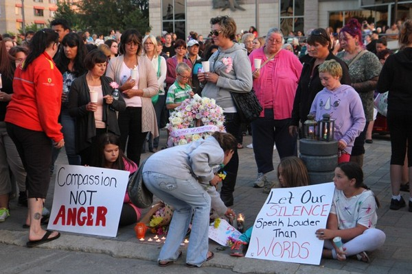 People lit candles in vigil that was sparked by city