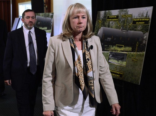 Transportation Safety Board of Canada chair Wendy Tadros is followed by TSB chief operating officer Jean Laporte as they enter a news conference in Lac-Mégantic, Que., on Tuesday, Aug. 19, 2014. The TSB released its report on the deadly Lac-Mégantic train derailment in July 2013.