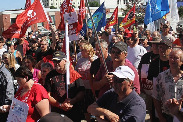 Protesters gathered outside city hall Monday to show support for the 900 Unifor Local 1075 members who are on strike at the local Bombardier plant.