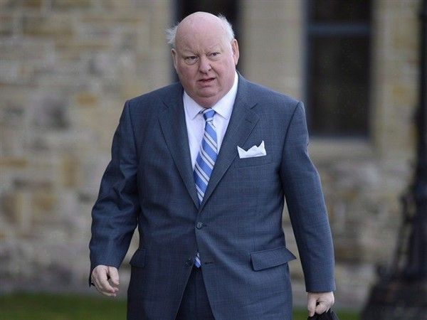 Sen. Mike Duffy arrives to the Senate on Parliament Hill in Ottawa, Monday, October 28, 2013. The NDP is asking Canada