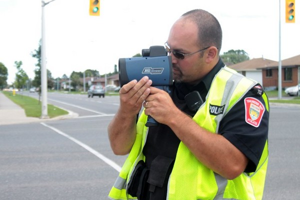 Thunder Bay Police Service Const. Jeff Carlson uses a LIDAR device to look for people driving over the speed limit Tuesday at the intersection of James Street and Victoria Avenue.