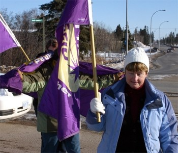 Service Employees International Union Local 1 members participate in a rally Tuesday.