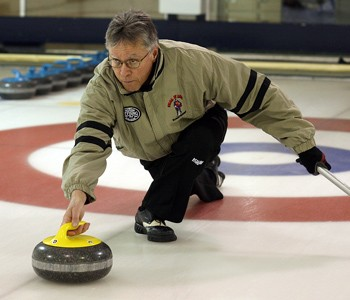 Two-time Brier champion Al Hackner attempts a shot at the Fort William Curling Club on Tuesday. Hackner's famous double takeout in the 10th end of the 1985 Brier on Monday was named the top moment in Northern Ontario curling history.